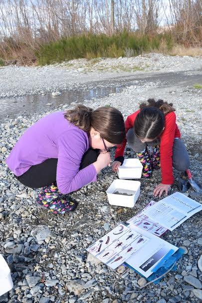 Holly taking macro-invertebrate samples with her sister Josie.